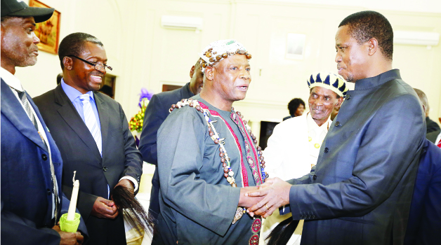 •PRESIDENT Lungu (right) chats with Chief Nkana after 15 Lamba Lima chiefs held a meeting with the Head of State at State House yesterday. Picture by EDDIE MWANALEZA/STATE HOUSE