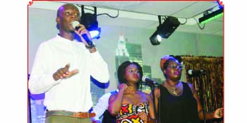 •Gospel artiste Pompi (left) entertains the audience at the Misty Jazz restaurant in Lusaka on Christmas Eve. Picture by CHRISTINE MWAABA