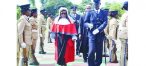 •ACTING Ndola High Court Judge-in-Charge Emelia Sunkuntu inspects a guard of honour during  the official opening of criminal sessions yesterday. Picture by MILDRED KATONGO