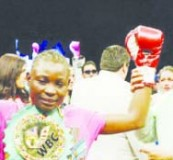 • World Boxing Council (WBC) gold Champion Catherin Phiri celebrates her victory.