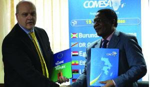 •Head of the European delegation to Zambia Ambassador Alessandro Mariani (left) exchange a copy of the agreement with the Common Market for Eastern and Southern Africa (COMESA) secretary general Sindiso Ngwenya. Picture courtesy of European Union