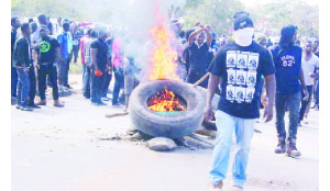 •PROTESTING students at the Copperbelt University burning tyres on the road to express their grievances.
