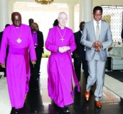 •President Edgar Lungu (right)escorts the Most Reverend and Right Honourable Justin Portal Welby, Archbishop of Canterbury and Reverend Albert Chama (left) Archbishop of Central Africa after he held talks with the clergymen at State House yesterday.  Picture by EDDIE MWANALEZA/STATE HOUSE.