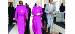 •President Edgar  Lungu (right) escorts the Most Reverend and Right Honourable Justin Portal Welby, Archbishop of  Canterbury and Reverend Albert Chama (left) Archbishop of Central Africa after he held talks with the clergymen at State House yesterday.  Picture by EDDIE MWANALEZA/STATE HOUSE.