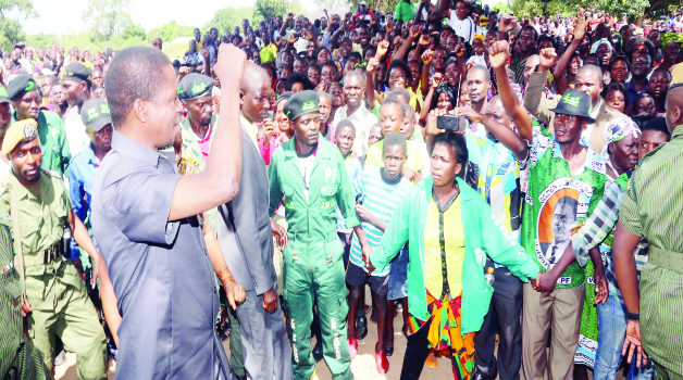 •President Edgar Lungu waves to the crowd at Mulilansolo Basic School in Chinsali, Muchinga Province before he addressed a rally .