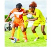 •ZAMBIA striker Noria Sosala tries to negotiate her way past two Zimbabwean defenders Schiela Nakoto (9) and Samkelisiwe Zulu (7) during Saturday's Africa Women Cup of Nations final round return leg clash at Nkoloma Stadium in Lusaka. Picture by GWEN CHIPASULA