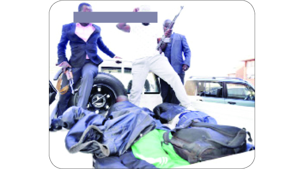 •SUSPECTED ritual killers aboard a police motor vehicle shortly after appearing before the Lusaka magistrate's court yesterday. Picture by CHUSA SICHONE