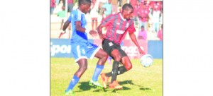 •Zanaco forward Aubrey Funga shields the ball from a combative Gift Wamundila of Nakambala Leopards in a league match played at the weekend. Picture by Gwen Chipasula