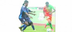 • ZESCO United forward Jackson Mwanza takes off as Lumwana Radiants defenders Enock Chingwele(3) and Andrew Banda (8) try to stop him during the 1-1 draw yesterday at Levy Mwanawasa Stadium. Picture by SAMUEL LUKHANDA