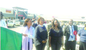 •Commerce, Trade and Industry permanent Secretary Kayula Siame (left) flags off a march past at Kafubu Mall in Ndola yesterday to mark the official opening of the 52nd  Zambia International Trade Fair. Picture by CHATULA  KANGALI