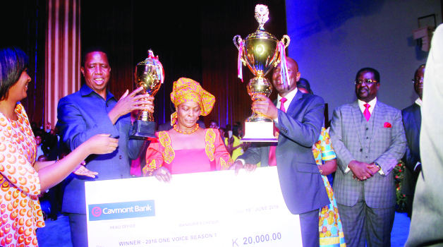 •President Lungu (second left), First Lady Esther (centre) with Busokololo choir director Kombe Mpundu (second right) and Bread of Life Church International overseer Joe Imakando (right)  after the Busokololo choir scooped the  ZNBC One Voice Grand Finale singing Competition at Bread of Life Church, Blessings Centre yesterday -Picture by THOMAS  NSAMA