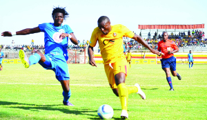 •POWER Dynamos' Fwayo Tembo (right) blazes past his Kabwe Warriors marker during yesterday's MTN-FAZ Super League Week 15 clash at Arthur Davies Stadium in Kitwe.