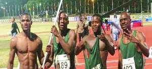 •L-R: Sprinters Sydney Siame, Hazemba Chindamba (with flag), Brian Kasinda and Titus Kafunda after winning bronze in the 4x100m relay at the CAA Senior Championship in South Africa. Picture courtesy of  Gerald Phiri's Instagram