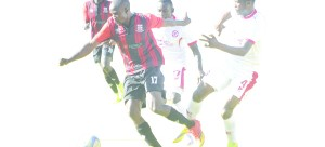•SOCCER fans scamper for safety after police fired teargas to disperse fans who wanted to enter the stadium by force prior to yesterday's MTN-FAZ Super League match between Zanaco and Nkana.