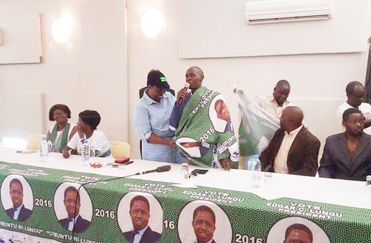 •PATRIOTIC Front (PF) chairperson for elections, Jean Kapata (in cap) welcomes United Party for National Development deputy spokesperson, Edwin Lifwekelo back to the PF yesterday.
