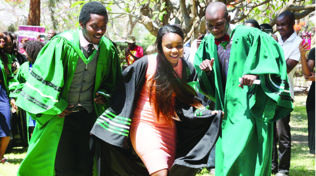 •ZAMBIA Institute of Mass Communication students celebrate during their graduation ceremony in Lusaka yesterday. Picture by SHABBY MULOPWE/ZANIS