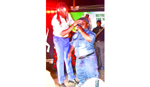 • Amayenge band member helps Chanda regain composure at Paddy  Blues recently.