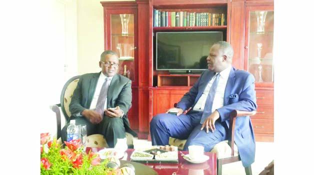 • FINANCE Minister Felix Mutati meeting with Nigerian investor Aliko Dangote (left). Picture by CHILESHE KANDETA