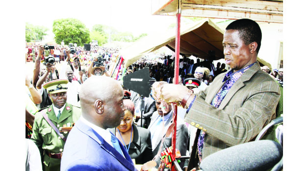 •President Edgar Lungu (right) confers the City Chain to Chipata Mayor Sinoya Mwale (left) during the Investiture ceremony at Civic Centre in Chipata after the President conferred Chipata Municipality to a City yesterday. PICTURE BY SALIM HENRY/STATE HOUSE