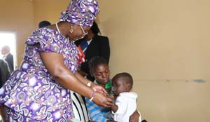• FIRST Lady Esther Lungu admires a baby during a tour and handover of food hampers to beneficiaries at Misissi Health Outreach Center at St.Lawrence Parish in Kamwala South, Lusaka. Picture by KACHA MIYOBA/ZANIS