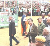 •PRESIDENT Edgar Lungu (brown jacket) gestures on arrival at Isoka Old Market to address a public rally in Isoka yesterday.  Picture by EDDIE MWANALEZA/STATE HOUSE