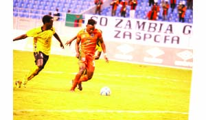 • ZESCO United striker Idriss Mbombo (right)  goes for goal under pressure from Le Messager Ngozi defender during yesterday's CAF Confederation Cup match at Levy Mwanawasa Stadium in Ndola.