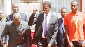 CELEBRATIONS continue - PRESIDENT Edgar Lungu gestures to former President Kenneth Kaunda (left), with Zambia Under-20 playmaker Enock Mwepu (right), at State House in Lusaka, when the Head of State hosted the team for a luncheon yesterday. Picture by JEAN MANDELA
