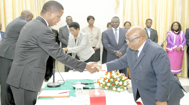 President Edgar Chagwa Lungu (left) congratulates Zambia's High Commissioner to Malawi Dr John Phiri (right) during the swearing in ceremony at State House in Lusaka yesterday. Picture By SALIM HENRY/STATE HOUSE