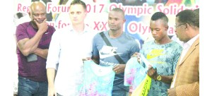 • FROM left to right: Coach Douglas Kalembo, Nike agent Kuba Wasowski with runners Sydney Siame, Kabange Mupopo and Zambia Amateur Athletics Association president Elias Mpondela at the Olympic Youth Development Centre (OYDC). Picture by ADRIAN MWANZA.