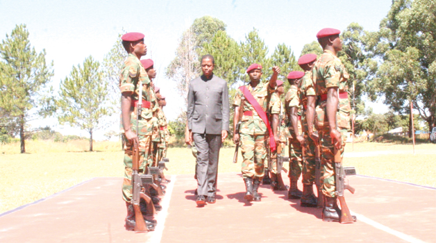 • PRESIDENT Edgar Lungu inspects a guard of honor on arrival at KARA Barracks in Kawambwa where Government is constructing 995 housing units for the 48 Marine Commandos. Picture by ALEX MUKUKA/ZANIS