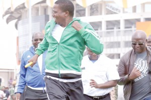 • CATCH me if you can: President Edgar Lungu sprints in a 100 metre relay at the Olympic Youth Development Centre in Lusaka yesterday during the launch of Health Week.  Picture by EDDIE MWANALEZA/STATE HOUSE