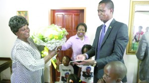 • President Edgar Lungu (right) presents a bouquet and gifts to  First Lady Esther during her 60th birthday celebrations yesterday Lusaka . Picture by SALIM HENRY/STATE HOUSE