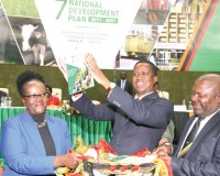 • Man with a Plan: PRESIDENT Edgar Lungu hoists the Seventh National Development Plan document during the launch at the Mulungushi International Conference Center in Lusaka yesterday. Picture by EDDIE MWANALEZA