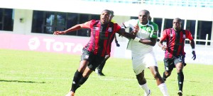 •ZANACO captain Ziyo Tembo in a tussle with Cotton Sport Christian Dyo Ngakole during the CAF Champions League match at National Heroes Stadium in Lusaka. Picture by ALLAN MATIYA