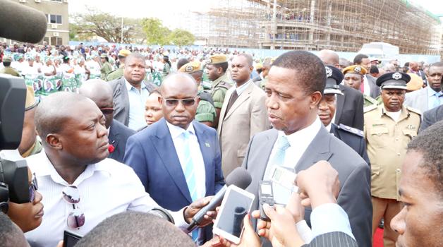 •PRESIDENT Edgar Lungu speaks to journalists at the Kenneth Kaunda International Airport before departure for Uganda in Lusaka yesterday. Picture by ROYD SIBAJENE/ZANIS