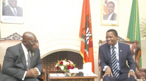 • PRESIDENT Edgar Lungu (right) and his Ghanaian counterpart Nana Akufo-Addo share a light moment before holding private talks at State House in Lusaka yesterday. Picture By SALIM HENRY/STATE HOUSE