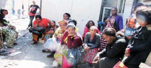 MARKETEERS gather outside the partially gutted City Market in Lusaka yesterday.