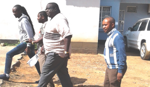 • FORMER Information and Broadcasting Services Minister Chishimba Kambwili (centre) after appearing before a fast track court at the Lusaka City Council yesterday. Picture by DELPHINE ZULU