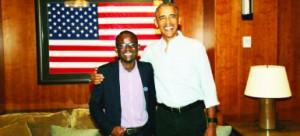 • Brighton Kaoma  with former US President Barack Obama in Washington recently.