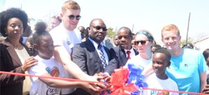 •ADAMS Peters (left), Sports Minister Moses Mawere and Mel Marsha (Right) about to cut the  ribbon during the official opening of the Kabwata play park. Picture by GODFREY DUBE