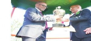 • SOUTH Africa President Jacob Zuma hands over a trophy to Zesco Limited  managing director Victor Mundende at Lusaka Showgrounds yesterday. Picture by Jean Mandela