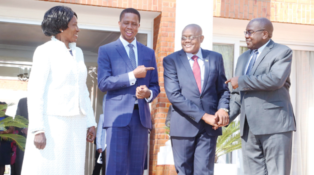 • PRESIDENT Edgar Lungu chats with Vice-President Inonge Wina (l) Health Minister Chitalu Chilufya (r) and newly appointed  Health Minister Permanent Secretary for administration Kennedy Malama after being sworn-in at State House yesterday. Picture by ROYD SIBAJENE/ZANIS