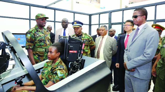 • PRESIDENT Lungu (in dark glasses) during the official opening of the Zambia Air Force L15 Flight Simulator Centre  at the ZAF Lusaka base yesterday. Pictures By EDDIE MWANALEZA/STATE HOUSE