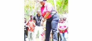 •FIRST LADY Esther Lungu lining up her tee shot during the Esther Lungu Foundation fundraising  golf tournament at State House in Lusaka yesterday. Picture by GODFREY DUBE