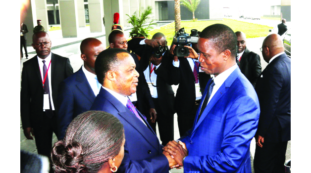 • PRESIDENT Edgar Lungu  (right) being welcomed by his Congo Brazzaville counterpart Denis Sassou Nguesso at the Presidential Hall in Brazzaville yesterday. Picture by SALIM HENRY/STATE HOUSE