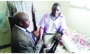 • SOUTHERN Province Minister Edify Hamukale (left) consoles Senior Chief Mweemba (right) from his hospital bed at Livingstone Central Hospital where he is receiving treatment. This follows the burning of his palace by unknown people, which led to the death of his grandson. Picture by BRIAN HATYOKA