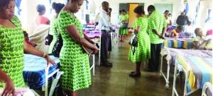 • Libala Church Choir members pray after donating baby blankets at Liteta Hospital Maternity Ward, some two years ago.