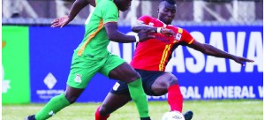 • Zambian striker Lameck Banda tries to evade a tackle from Uganda's Muhamed Kasule in a Cosafa Cup U-20 Group-A encounter at Arthur Davis Stadium in Kitwe. Picture courtesy BackpagePix