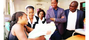 •  REBECCA Phiri shows President Edgar Lungu her baby named Favour, one of those born on New Year at Bauleni clinic yesterday. On the President's left is Health Minister Chitalu Chilufya. The President presented hampers to five New Year babies at the clinic.  Picture By EDDIE MWANALEZA/State House
