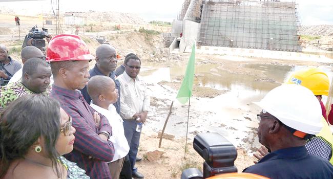 .President Lungu (in red hard hat)